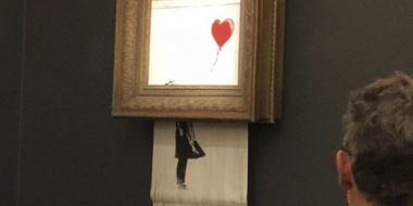 【芸術】バンクシーの絵画、140万ドルで落札された直後に「自滅」する  額縁に隠しシュレッダー 内臓 [動画]