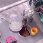 【動画】中国、マンホールを開けて下水道から「地溝油」をせっせと汲み出す男