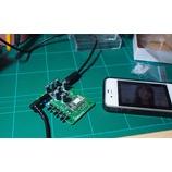 『iPhone(iPod)& iPad、Nexus 7(Android)に入れた音楽や動画の音をBluetoothを使って車のオーディオで聴くために、ケースに入れたOLA-BT1を使う。』の画像