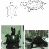 『山西黒 亀彫刻』の画像