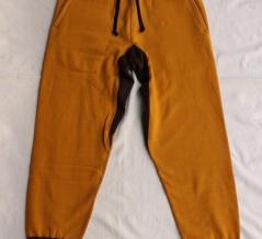 FREEWHEELERS / SWEAT PANTS (OLD GOLD × SOOT BLACK)
