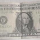 『1ドルの重みと献金』の画像